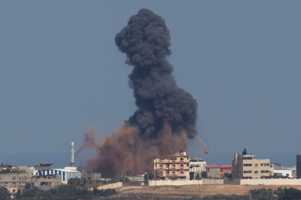 Description of . Smoke and dust rise from an Israeli missile strike in Gaza strip, seen from the Israel Gaza Border, Wednesday, July 16, 2014.  A Hamas website says Israel has fired missiles at the homes of four of its senior leaders as it resumed bombardment of Gaza, following a failed Egyptian cease-fire effort. Wednesday's bombings came after Hamas rejected an Egyptian truce proposal on Tuesday and instead launched more rockets at Israel. (AP Photo/Ariel Schalit)