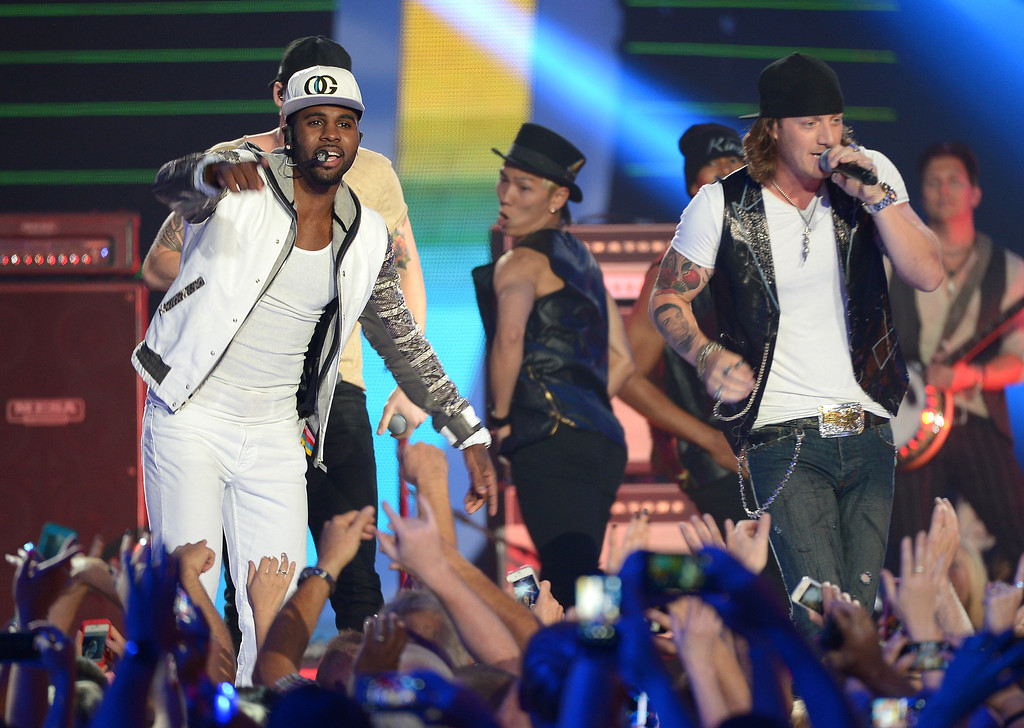 Description of . Jason Derulo and Tyler Hubbard of Florida Georgia Line perform onstage at the 2014 CMT Music Awards at Bridgestone Arena on June 4, 2014 in Nashville, Tennessee.  (Photo by Michael Loccisano/Getty Images for CMT)