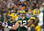 Quarterback Aaron Rodgers #12 of the Green Bay Packers throws the ball to running back Ryan Grant #25 in the first half against the Minnesota Vikings during the NFC Wild Card Playoff game at Lambeau Field on January 5, 2013 in Green Bay, Wisconsin.  (Photo by Andy Lyons/Getty Images)
