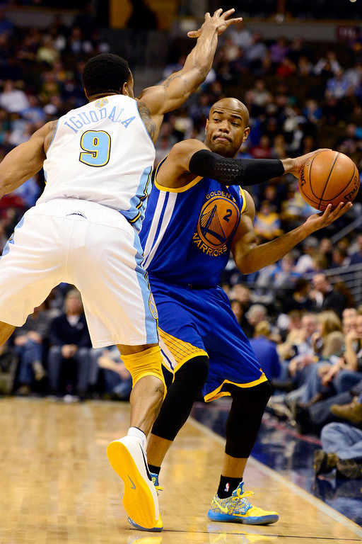 Description of . Denver Nuggets shooting guard Andre Iguodala (9) defends Golden State Warriors point guard Jarrett Jack (2) during the second half of the Nuggets' 116-105 win at the Pepsi Center on Sunday, January 13, 2013. AAron Ontiveroz, The Denver Post
