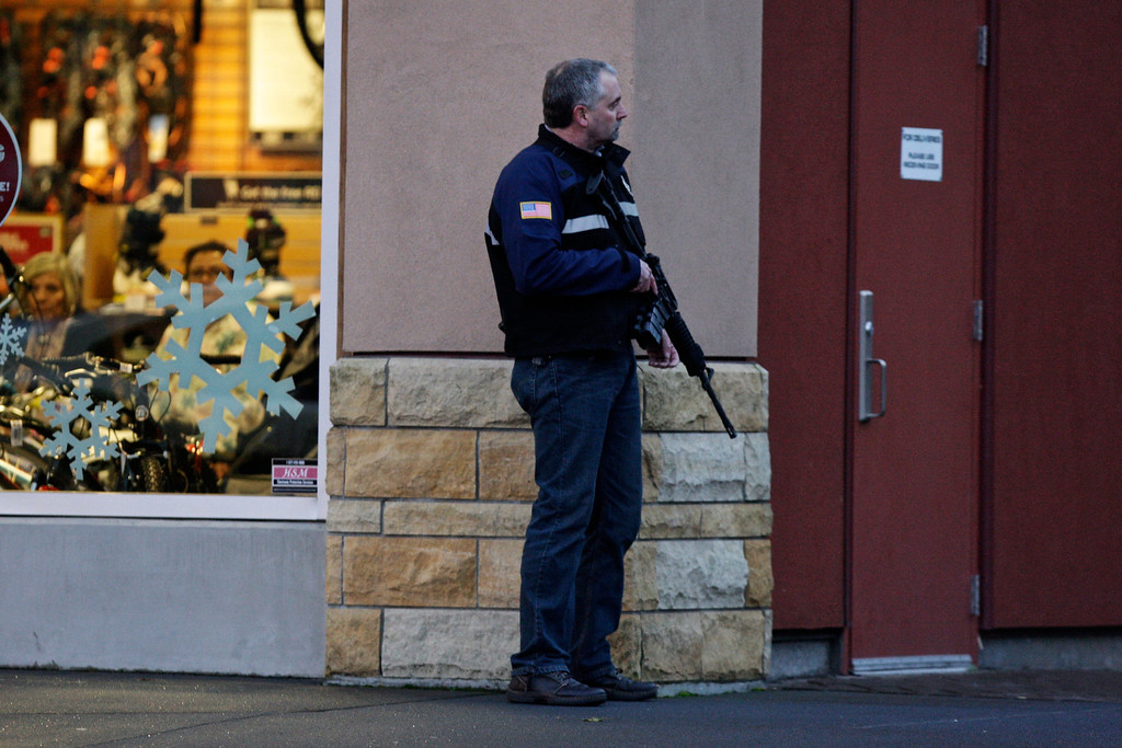 Description of . A law enforcement official secures the scene after a shooting at Clackamas Town Center in Portland, Ore., Tuesday, Dec. 11, 2012. A gunman is dead after opening fire at the shopping mall Tuesday, killing two people and wounding another, sheriff's deputies said. (AP Photo/The Oregonian, Thomas Boyd)