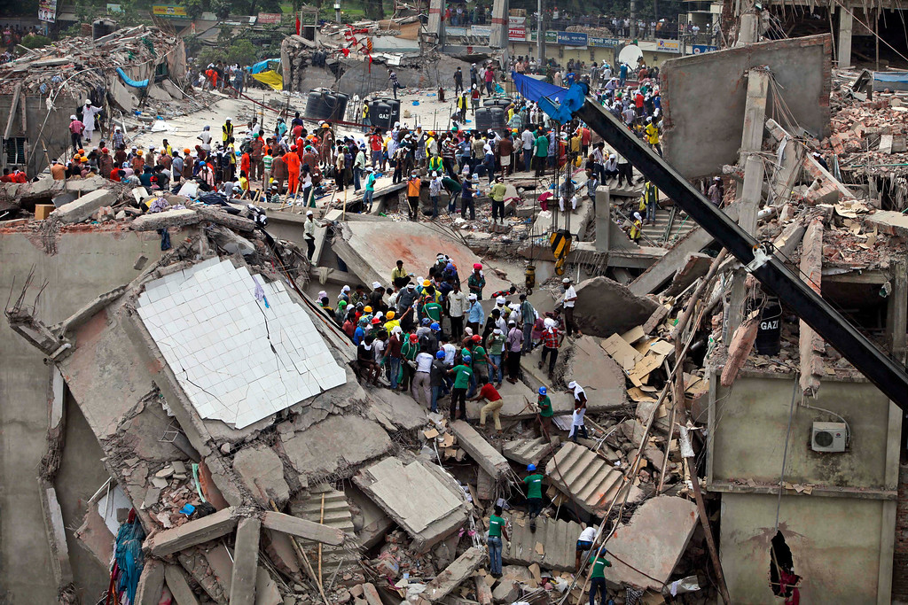 Description of . Bangladeshi rescuers work at the site of a building that collapsed Wednesday in Savar, near Dhaka, Bangladesh, Thursday, April 25, 2013. AP Photo/A.M. Ahad)