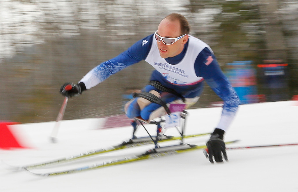 Description of . Andrew Soule of United States races during the 15km men's cross country ski, sitting event at the 2014 Winter Paralympic, Sunday, March 9, 2014, in Krasnaya Polyana, Russia. (AP Photo/Dmitry Lovetsky)