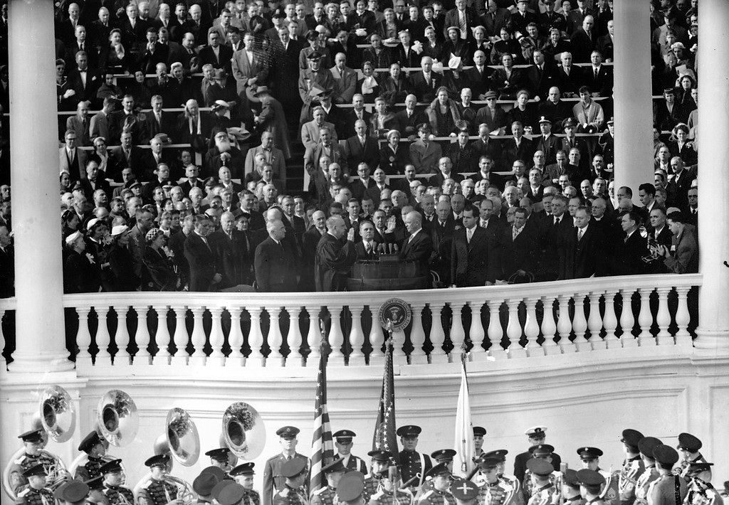 Description of . Dwight D. Eisenhower is inaugurated as U.S. President. U.S. Chief Justice Fred Vinson administers the oath of office during the Capitol ceremony in Washington D.C. on Jan. 20, 1953. Richard Nixon, the new U.S. Vice President is standing on the right. (AP Photo)