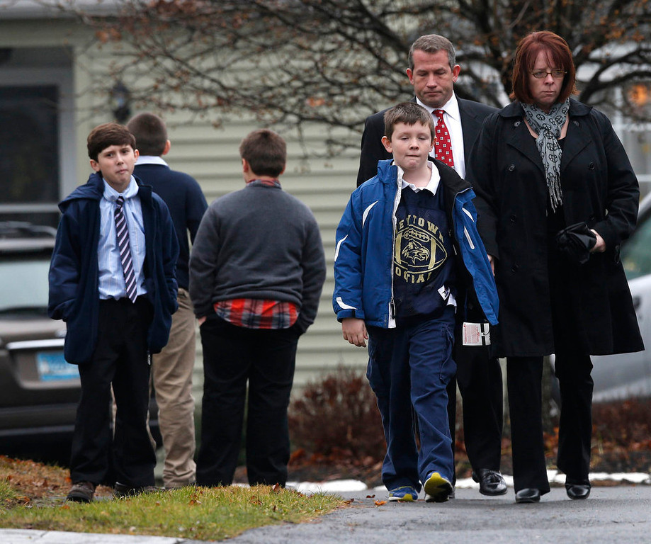 Description of . Mourners leave the Honan Funeral Home, where the family of six-year-old Jack Pinto is holding his funeral service, in Newtown, Connecticut December 17, 2012. Pinto was one of the 20 students killed in the December 14 shootings at Sandy Hook Elementary School in Newtown. REUTERS/Mike Segar