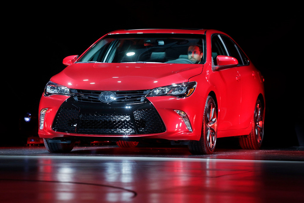 Description of . The 2015 Toyota Camry is introduced at the New York International Auto Show, Wednesday, April 16, 2014, in New York. (AP Photo/Mark Lennihan)