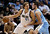 Dallas Mavericks power forward Dirk Nowitzki (41), of Germany, fights for position against Denver Nuggets small forward Danilo Gallinari of Italy, in the first half of an NBA basketball game on Friday, Dec. 28, 2012, in Dallas. The game was Nowitzki's first at home this season since returning from knee surgery. (AP Photo/Tony Gutierrez)