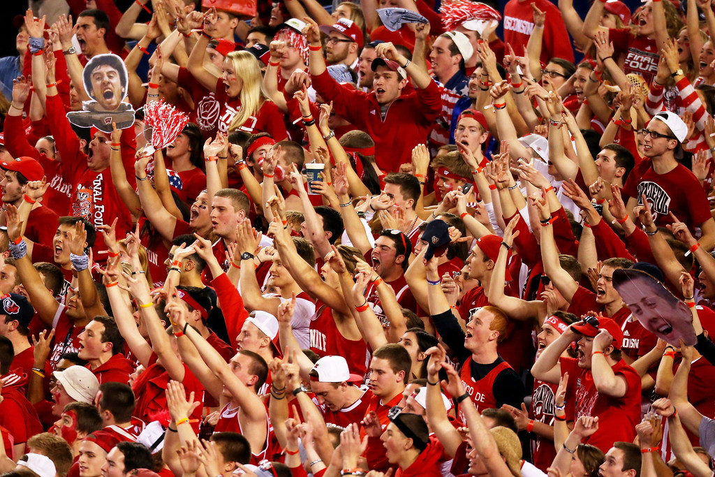 Description of . ARLINGTON, TX - APRIL 05:  Wisconsin Badgers fans cheer during the NCAA Men's Final Four Semifinal against the Kentucky Wildcats at AT&T Stadium on April 5, 2014 in Arlington, Texas.  (Photo by Ronald Martinez/Getty Images)