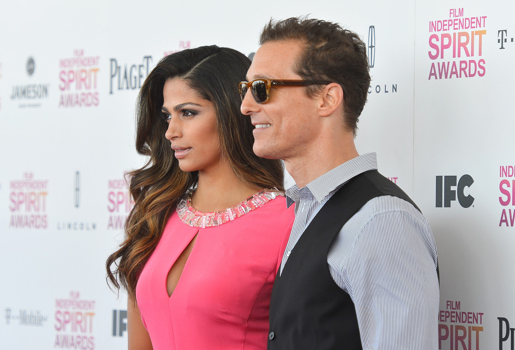 Description of . SANTA MONICA, CA - FEBRUARY 23:  Actor Matthew McConaughey (R) and model Camila Alves attend the 2013 Film Independent Spirit Awards at Santa Monica Beach on February 23, 2013 in Santa Monica, California.  (Photo by Frazer Harrison/Getty Images)