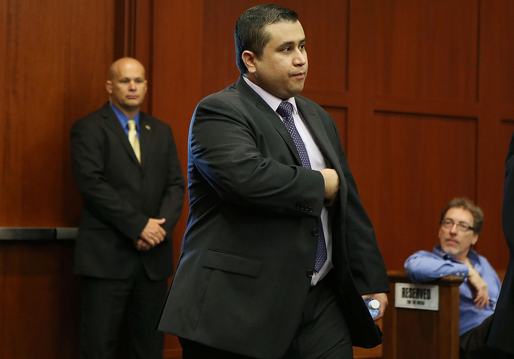 Description of . George Zimmerman enters the courtroom for his trial before the jury continued their deliberations in Seminole circuit court in Sanford, Fla. Saturday, July 13, 2013. Zimmerman has been charged in the 2012 shooting death of Trayvon Martin. (AP Photo/Orlando Sentinel, Gary W. Green, Pool)