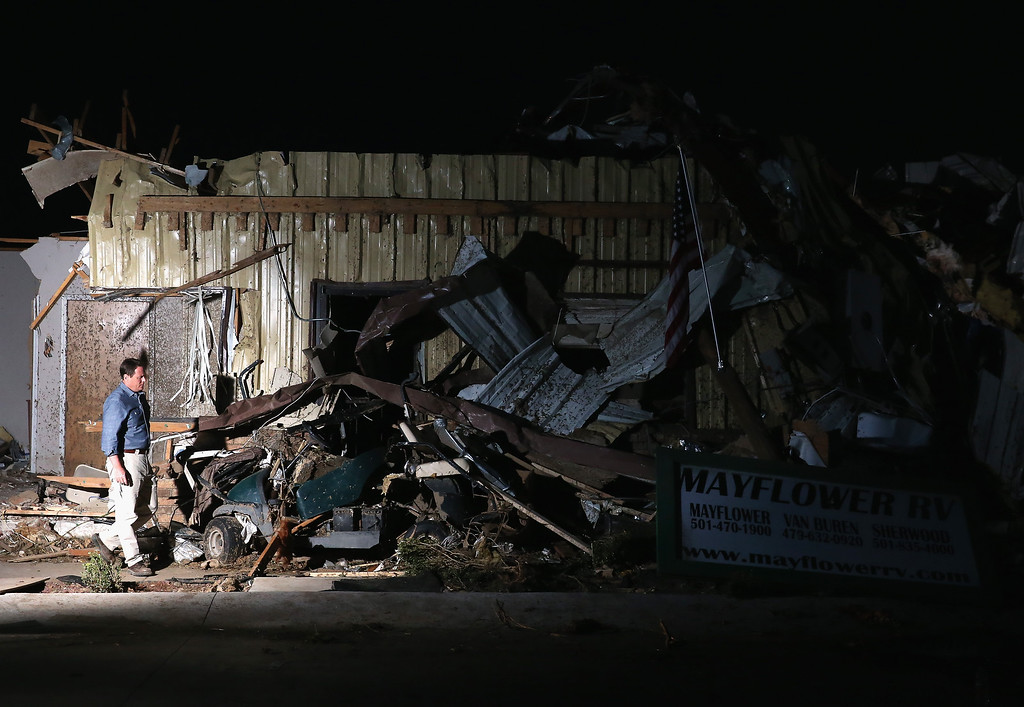 Description of . A man walks past a building that was destroyed by a tornado yesterday when it tore through the area for the second time in three years, on April 28, 2014 in Mayflower, Arkansas. After deadly tornadoes ripped through the region leaving more than a dozen dead, Mississippi, Arkansas, Texas, Louisiana and Tennessee are all under watch as multiple storms over the next few days are expected.  (Photo by Mark Wilson/Getty Images)