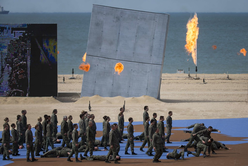 Description of . Actors perform during an international D-Day commemoration ceremony on the beach of Ouistreham, Normandy, on June 6, 2014, marking the 70th anniversary of the World War II Allied landings in Normandy.  AFP PHOTO / POOL / IAN LANGSDON/AFP/Getty Images