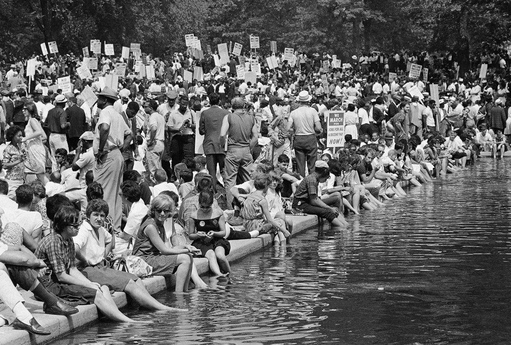 Description of . A crowd gathers near the reflecting pooll in Washington, Aug. 28, 1963, to hear speakers in ceremonies following the March on Washington parade through the Capitol streets. (AP Photo)
