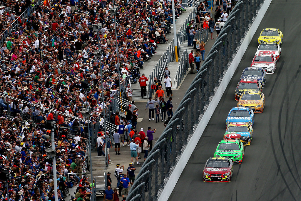 Description of . Jeff Gordon, driver of the #24 Drive To End Hunger Chevrolet, leads a pack of cars during the NASCAR Sprint Cup Series Daytona 500 at Daytona International Speedway on February 24, 2013 in Daytona Beach, Florida.  (Photo by Jonathan Ferrey/Getty Images)