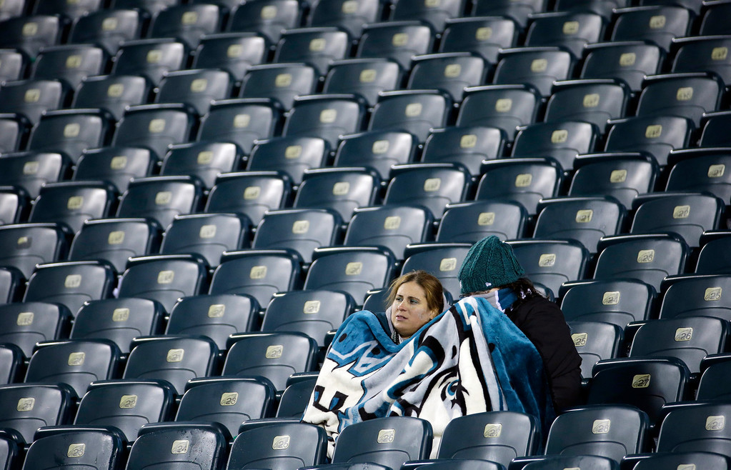 Description of . Philadelphia Eagles fans sit in the stands after the Eagles lost an NFL wild-card playoff football game against the New Orleans Saints, 26-24, Saturday, Jan. 4, 2014, in Philadelphia. (AP Photo/Matt Rourke)