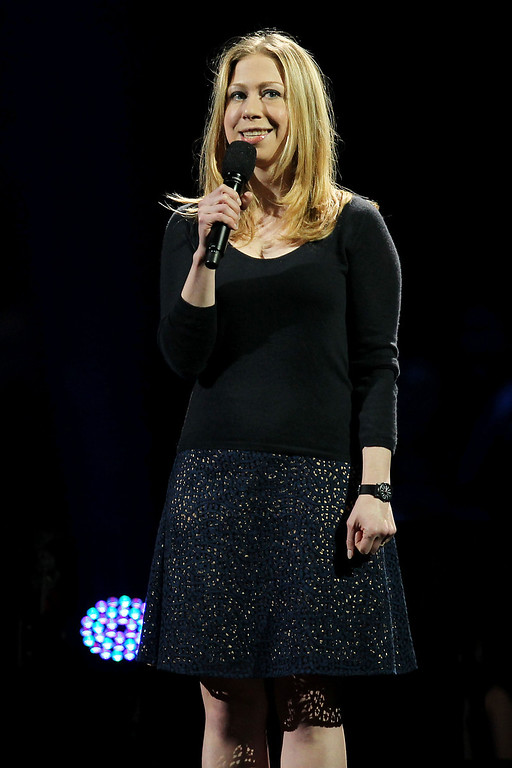 Description of . This image released by Starpix shows Chelsea Clinton speaking at the 12-12-12 The Concert for Sandy Relief at Madison Square Garden in New York on Wednesday, Dec. 12, 2012. Proceeds from the show will be distributed through the Robin Hood Foundation. (AP Photo/Starpix, Dave Allocca)