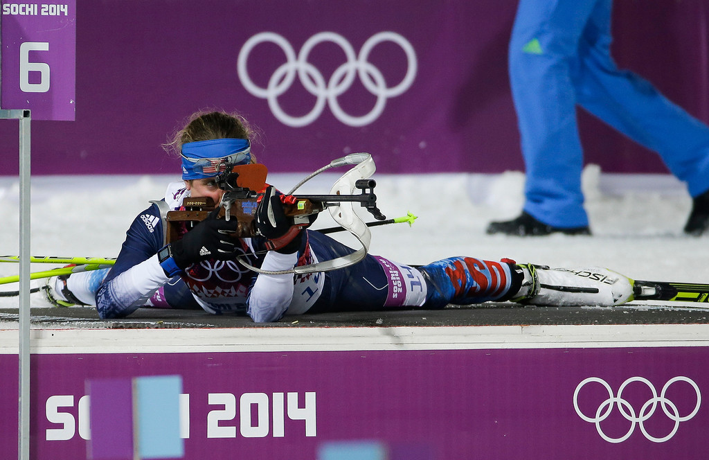 Description of . United States\' Susan Dunklee shoots during the women\'s biathlon 10k pursuit, at the 2014 Winter Olympics, Tuesday, Feb. 11, 2014, in Krasnaya Polyana, Russia. (AP Photo/Gero Breloer)