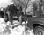 People lending a hand to a stuck driver after the Blizzard of '82. Denver Post Library Archive