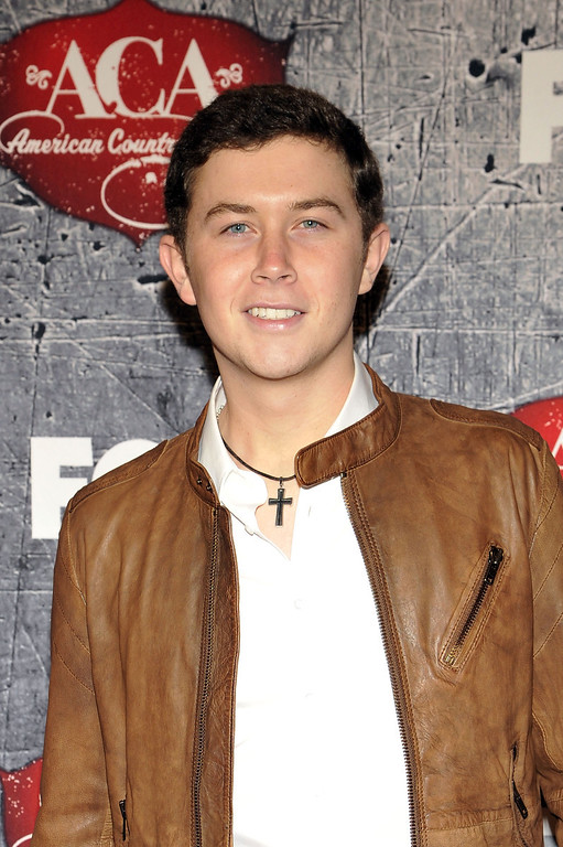 Description of . Singer Scotty McCreery arrives at the American Country Awards on Monday, Dec. 10, 2012, in Las Vegas. (Photo by Jeff Bottari/Invision/AP)
