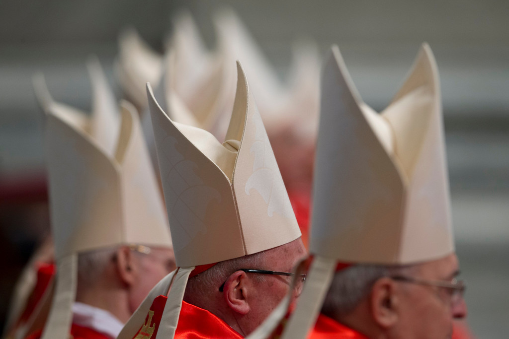 Description of . Cardinals attend a Mass for the election of a new pope celebrated by Cardinal Angelo Sodano inside St. Peter\'s Basilica, at the Vatican, Tuesday, March 12, 2013.  (AP Photo/Andrew Medichini)
