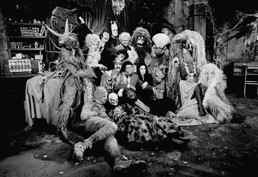 Description of . Just about every horror monster ever invented for the movie industry was assembled by Sonny Bono and Cher and their guest star, Jerry Lewis, center, for the taping of their television show to be aired by CBS on Halloween, Friday, Oct. 4, 1973, Los Angeles, Calif. In the group, among others, are Frankensteins monster, Dracula, the Mad Scientist, Wolfman, Sea Monster, Cyclops, Bat Girl, and Bride of Frankenstein. (AP Photo/David F. Smith)