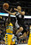 Spurs guard Tony Parker (9) flew to the hoop past Denver guard Ty Lawson (3) in the first half. The Denver Nuggets hosted the San Antonio Spurs at the Pepsi Center Tuesday night, December 18, 2012. Karl Gehring/The Denver Post