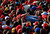 A supporter of Venezuela's late President Hugo Chavez is lifted out of the crowd after fainting while waiting for a chance to view his body at the military academy in Caracas March 8, 2013. Chavez will be embalmed and put on display 