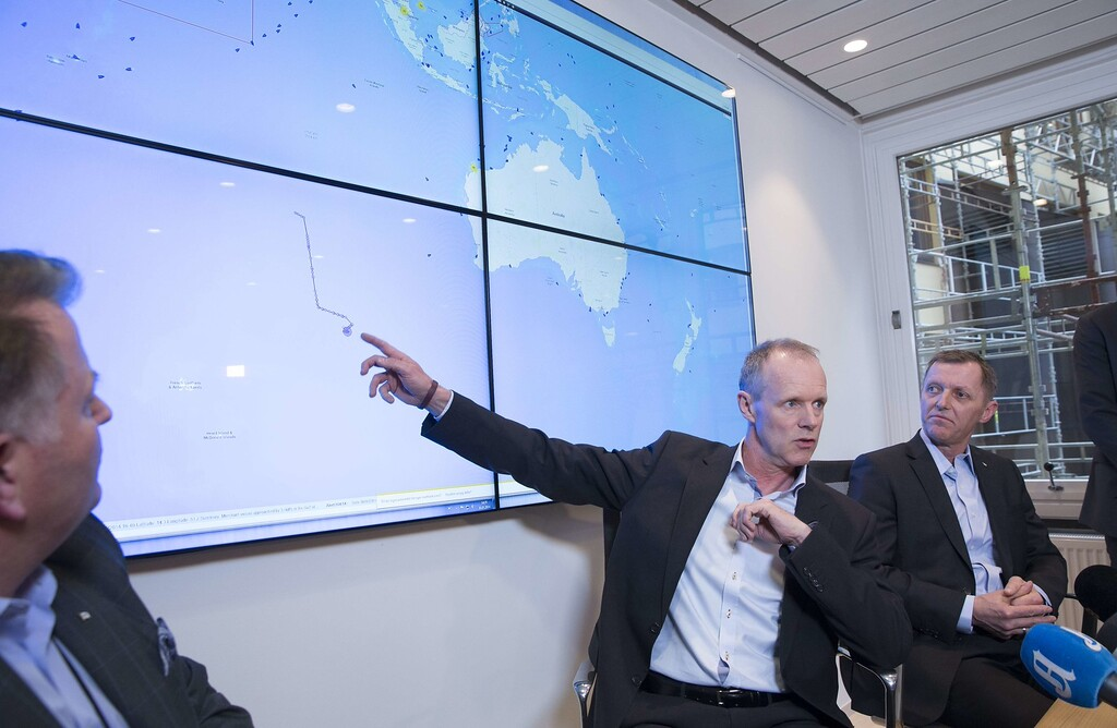 Description of . Sturla Henriksen, director general of the Norwegian Shipowner's Association (C) and Ingar Skiaker, CEO of Hoeegh Autoliners attend a press conference on March 20, 2014 in Oslo on the movements of the vessel
