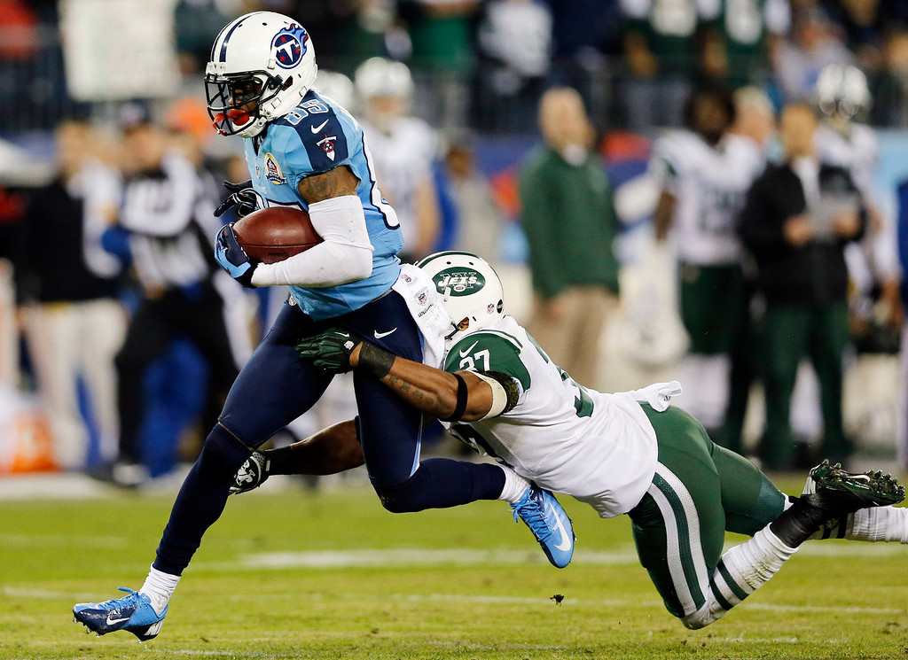 Description of . New York Jets strong safety Yeremiah Bell (37) brings down Tennessee Titans wide receiver Nate Washington (85) in the first quarter of an NFL football game, Monday, Dec. 17, 2012, in Nashville, Tenn. (AP Photo/Joe Howell)