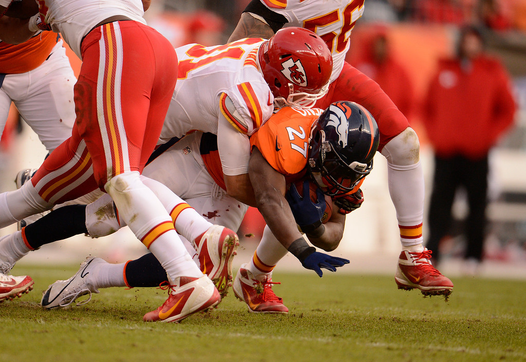 Description of . Denver Broncos running back Knowshon Moreno (27) is tackled in the third quarter as the Denver Broncos took on the Kansas City Chiefs at Sports Authority Field at Mile High in Denver, Colorado on December 30, 2012. John Leyba, The Denver Post