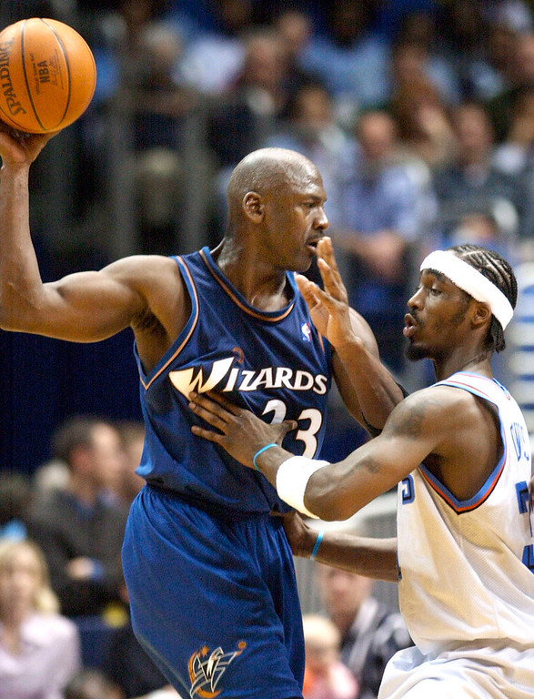 Description of . Cleveland Cavaliers' Ricky Davis, right, defends against Washington Wizards' Michael Jordan (23) during the fourth quarter of Washington's 100-91 win Tuesday, April 8, 2003, in Cleveland. Jordan scored 26 points and had 10 rebounds to lead the Wizards. (AP Photo/Mark Duncan)