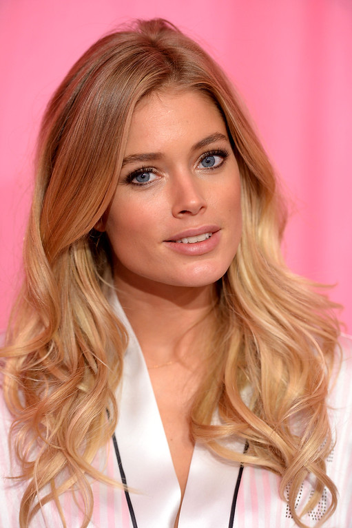 Description of . Model Doutzen Kroes prepares at the 2013 Victoria's Secret Fashion Show hair and make-up room at Lexington Avenue Armory on November 13, 2013 in New York City.  (Photo by Dimitrios Kambouris/Getty Images for Victoria's Secret)
