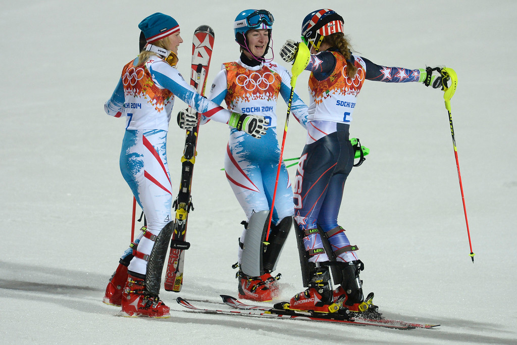 Description of . Gold medalist American Mikaela Shiffrin (right) celebrates with silver medalist Marlies Schild of Austria (left) and bronze medalist Kathrin Zettel (both of Austria) after ladies' slalom run 2. Sochi 2014 Winter Olympics on Friday, February 21, 2014 at Rosa Khutor Alpine Center. (Photo by AAron Ontiveroz/ The Denver Post)
