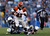 Running back BenJarvus Green-Ellis #42 of the Cincinnati Bengals breaks the tackle of free safety Eric Weddle #32  and defensive end Corey Liuget #94 of the San Diego Chargers in the second half at Qualcomm Stadium on December 2, 2012 in San Diego, California. The Bengals defeated the Chargers 20-13. (Photo by Jeff Gross/Getty Images)