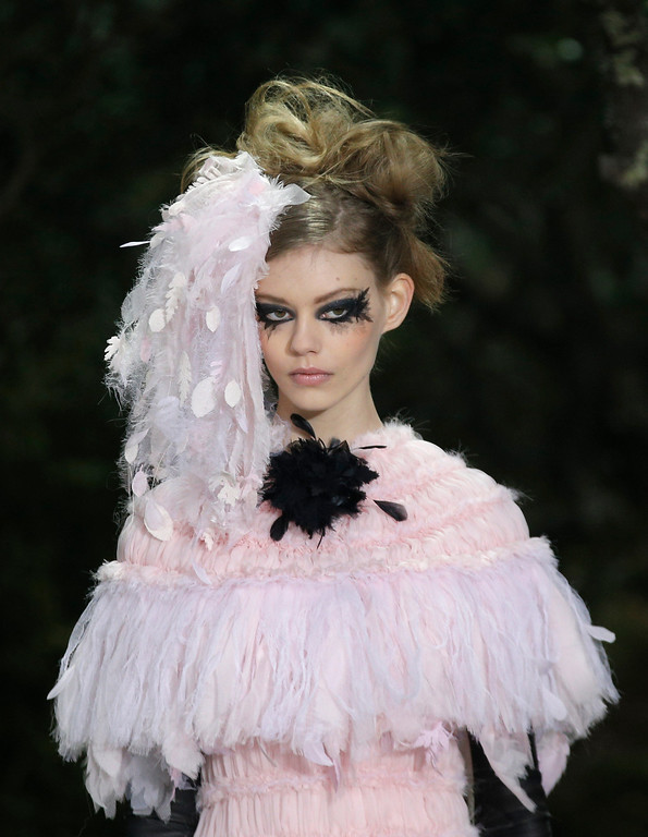 Description of . A model wears a creation by German fashion designer Karl Lagerfeld for Chanel's Spring Summer 2013 Haute Couture fashion collection, presented in Paris, Tuesday, Jan.22, 2013. (AP Photo/Christophe Ena)