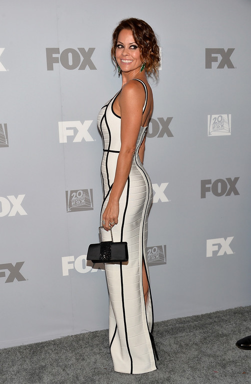 Description of . TV personality Brooke Burke Charvet attends the FOX Broadcasting Company, Twentieth Century FOX Television and FX Post Emmy Party at Soleto on September 22, 2013 in Los Angeles, California.  (Photo by Alberto E. Rodriguez/Getty Images)