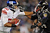Wide receiver Victor Cruz #80 of the New York Giants stiff arms cornerback Corey Graham #24 of the Baltimore Ravens in the third quarter at M&T Bank Stadium on December 23, 2012 in Baltimore, Maryland. The Baltimore Ravens won, 33-14.  (Photo by Patrick Smith/Getty Images)