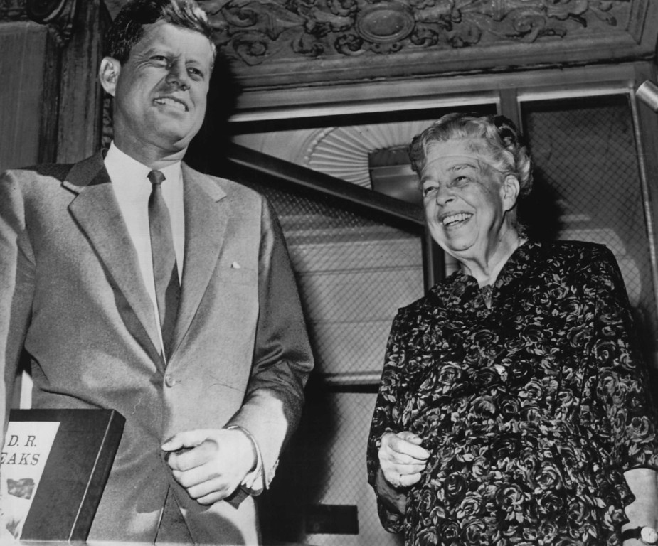 . Mrs. Eleanor Roosevelt and Sen. John F. Kennedy pose outside Roosevelt\'s New York residence after their breakfast meeting on Oct. 26, 1960. Kennedy holds a record album of speeches of President Franklin D. Roosevelt, which was presented to him at the meeting.