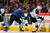 David Perron #57 of the St. Louis Blues controls the puck against John Mitchell #7 of the Colorado Avalanche at the Pepsi Center on February 20, 2013 in Denver, Colorado.  (Photo by Doug Pensinger/Getty Images)
