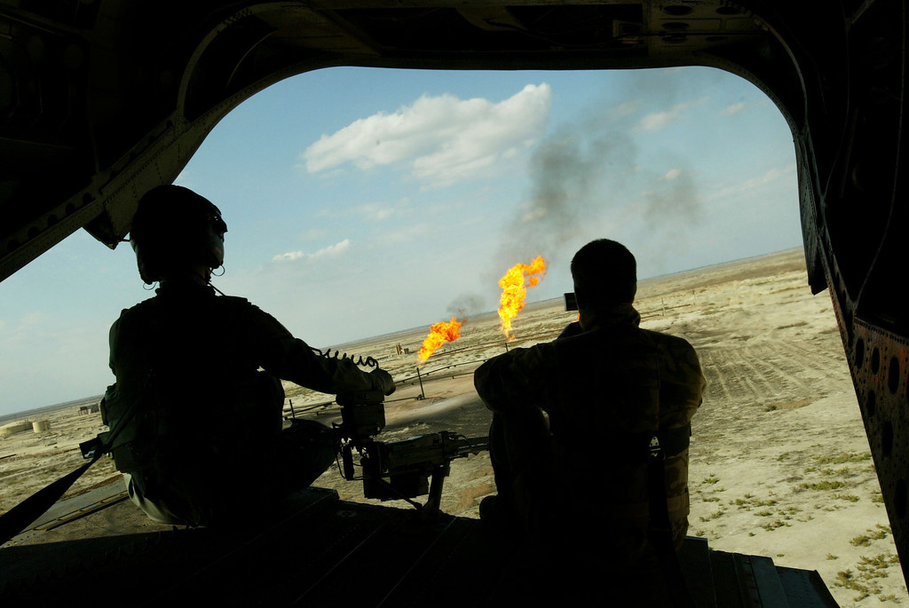 Description of . British solders with the Welsh Guards battle group man a heavy machine gun at the back of a Chinook helicopter February 8, 2005 above the southern Iraqi city of Ammarah. (Photo by Ghaith Abdul-Ahad/Getty Images)
