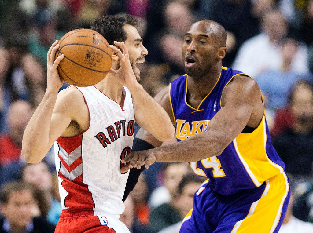 Description of . Toronto Raptors guard Jose Calderon, left, protects the ball from Los Angeles Lakers guard Kobe Bryant, right, during the first half of an NBA basketball game, Sunday, Jan. 20, 2013, in Toronto. The Raptors won 108-103. (AP Photo/The Canadian Press, Nathan Denette)