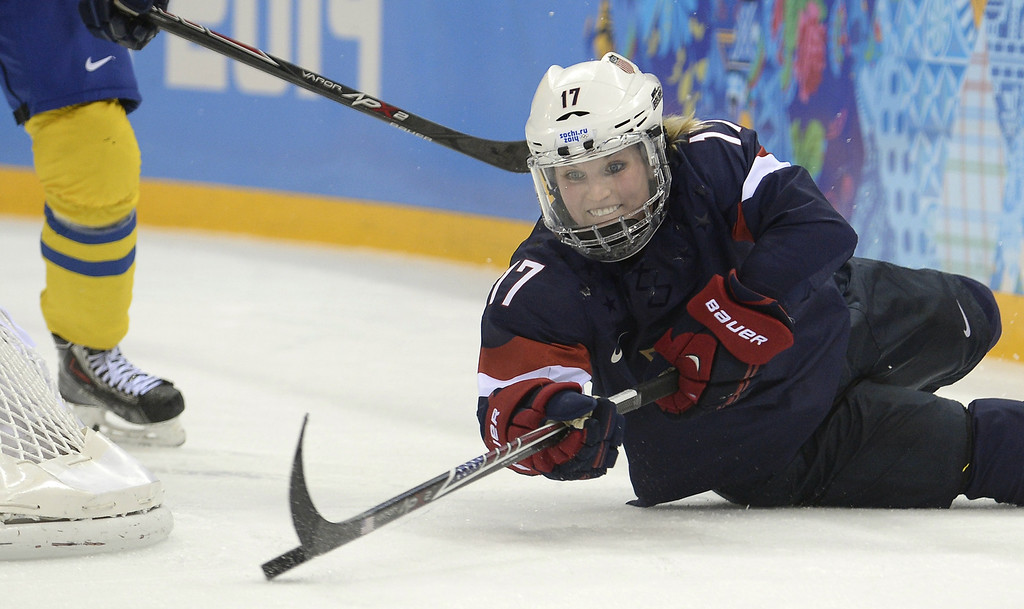 Description of . US Jocelyne Lamoureux attacks the net during the Women's Ice Hockey Semifinals USA vs Sweden at the Shayba Arena during the Sochi Winter Olympics on February 17, 2014.    ALEXANDER NEMENOV/AFP/Getty Images