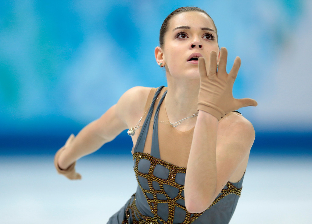 Description of . Adelina Sotnikova of Russia competes in the women's free skate figure skating finals at the Iceberg Skating Palace during the 2014 Winter Olympics, Thursday, Feb. 20, 2014, in Sochi, Russia. (AP Photo/Ivan Sekretarev)