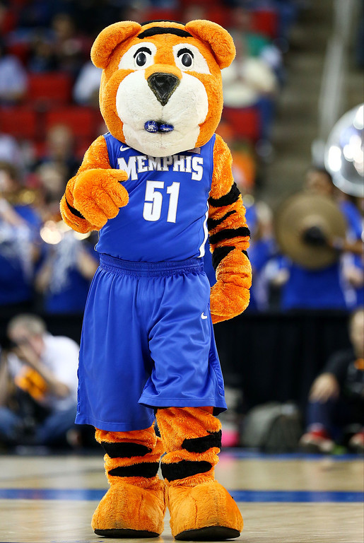 Description of . Memphis Tigers mascot, Pouncer, performs in the first half against the George Washington Colonials during the Second Round of the 2014 NCAA Basketball Tournament at PNC Arena on March 21, 2014 in Raleigh, North Carolina.  (Photo by Streeter Lecka/Getty Images)