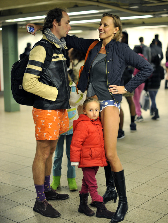 Description of . Riders wait for a train in the New York subway in their underwear as they take part in the 2014 No Pants Subway Ride on January 12, 2014. Started by Improv Everywhere, the goal is for riders to get on the subway train dressed in normal winter clothes without pants and keep a straight face. TIMOTHY A. CLARY/AFP/Getty Images
