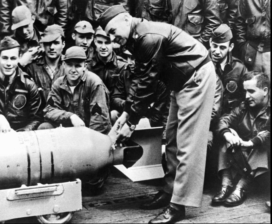 . U.S. Army Air Corps Maj. Gen. James Doolittle fastens a medal on the tail of a 500-lb. bomb that he and the crew of sixteen B-25s dropped on Tokyo during a suprise raid on April 18, 1942. Doolittle and his crews\' attack shocked the Japanese military establishment at a time when the Allies war effort in the Pacific seemed to be bad news following bad news from Bataan to Wake Island. (AP Photo/File)
