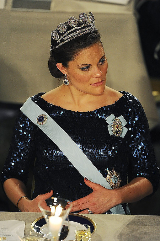 Description of . Crown Princess Victoria of Sweden touches her pregnant belly at the Nobel Prize Banquet at Stockholm City Hall on December 10, 2011 in Stockholm, Sweden.  (Photo by Pascal Le Segretain/Getty Images)