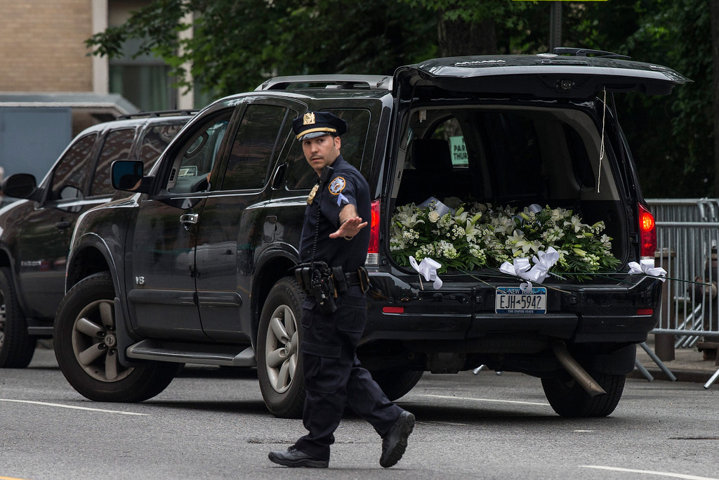 Description of . A car filled with flowers arrives prior to the funeral for Actor James Gandolfini at The Cathedral Church of St. John the Divine on June 27, 2013 in New York City.   (Photo by Andrew Burton/Getty Images)