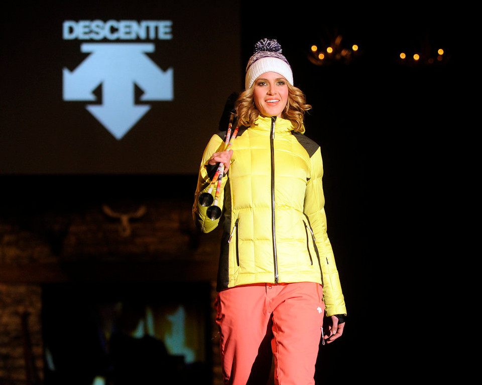 Description of . Descente  yellow and black puff jacket and  snow gear, as the SIA Snow Show hosted its 2013 Snow Fashion & Trends Show at the Colorado Convention Center  in downtown Denver  on Wednesday, January 30, 2013.  (Photo By Cyrus McCrimmon / The Denver Post)