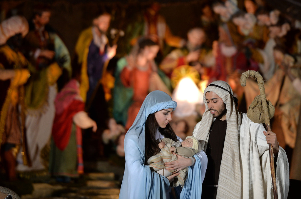 Description of . People play a nativity scene during the unveiling ceremony of the crib in St Peter's Square at the Vatican, on December 24, 2013. Pope Francis visited his predecessor Benedict XVI yesterday for an informal Christmas greeting, as the Argentine pontiff prepares to celebrate his first Christmas as leader of the world's Roman Catholics.   FILIPPO MONTEFORTE/AFP/Getty Images